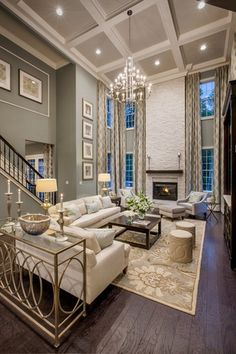 Traditional Living Room with Box ceiling, High ceiling, Cement fireplace, Hardwood floors, Chandelier, Crown molding