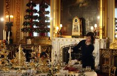 Royal Collection exhibition administrator Roxy Hackett applies the finishing touches to a festive table in the State Dinning Room at Windsor Castle... Beautiful Stunning table decorations !!
