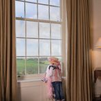 Double hung windows offer singular traditional style. Multi-pane windows add architectural interest to rooms of any style
