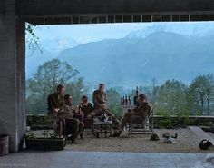 Men of 'Easy Company' 2nd Btn. 506 PIR, 101st Airborne, celebrate V-E day in Berchtesgaden in the Bavarian Alps, May 8 1945 (Easy Company arrived there on May 5th)  Left to right: Major Richard D. Winters, Captain Lewis Nixon, First Lieutenant Harry F. Welsh, First Lieutenant Thomas A. Peacock and Capt. Lloyd J. Cox.  (Colorized by Jared Enos from the USA)