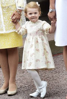 Swedish little Princess Estelle looked adorable in a floral dress with white tights and shoes and had a pretty bow in her hair, as she attends to celebrates Victoria Day in honor of her mother turning 37 on 14.07.2014