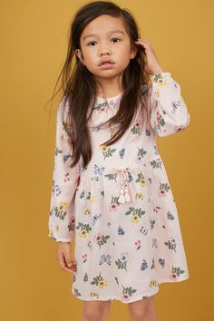 Dress in woven modal fabric with a printed pattern. Round neckline with gathers at front and small opening at back of neck with button. Unicorn Kids, Decorative Bows, Frocks For Girls, Sleeve Styles, Dress Skirt, New Baby Products, Floral Tops, Girl Outfits, Long Sleeve