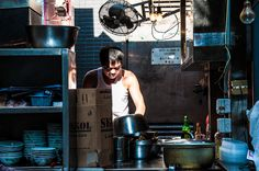 Between shadow and light, this working class hero prepares some delicious street food in Hong Kong.  #food #hongkong #photography
