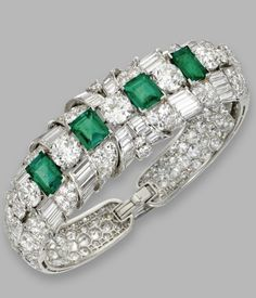 Platinum, emerald and diamond bangle-brancelet, Raymond Yard, circa 1940. Set at the front with emerald-cut emeralds weighing approximately 6.25 carats, accented by old European-cut, single-cut, baguette and tapered baguette diamonds weighing a total of approximately 31.80 carats, internal circumference 6¼ inches, signed Yard