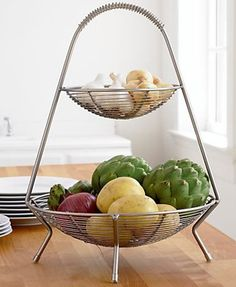 Corral root vegetables or fruit in this airy basket that will still leave plenty of countertop storage room for other pantry fixtures. It's even nice enough to bring out of hiding when entertaining. Handled 2-Tier Wire Fruit Basket, about $20; Craft & Barrel