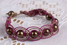 Brown and burgund hemp with glass pearl beads. SOLD  Email me for more info: dkwilson68@hotmail.com