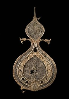 Steel 'Alam, Iran, first half of the 17th century. The standards carried in Shi'i religious processions, called 'alams, originated in battle standards where they indicated the presence of the ruler. From the Qum section. © The Trustees of the British Museum.