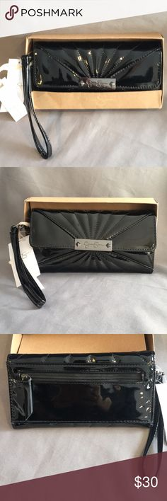 NWT Jessica Simpson Zoe Black Wristlet Clutch NWT Jessica Simpson Shiny Zoe Black Wristlet Clutch. The wristlet is detachable. The wristlet button snaps closed. On the outside there is a zipper pocket for change. On the inside there are 12 pockets for credit cards. 1 pocket open for cash and 2 wide open pockets for your personal items. Measures approx 4x7.5x1 inches. Checkout my other listings and add to a bundle to save! Jessica Simpson Bags Clutches & Wristlets