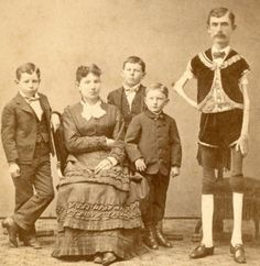 This is I. W.Sprague (Isaac) & family .The original Thin Man . Born in Mass. in 1841,he was a normal child ,until about 12 yr.,when he began losing weight .He joined the circus in 1865, eventually working for P.T. Barnum. In this photo , he is 44 yr. / 5 ft . 6 in / 43 pounds.