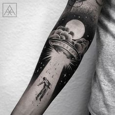 Alien abduction tattoo. Forearm tattoo