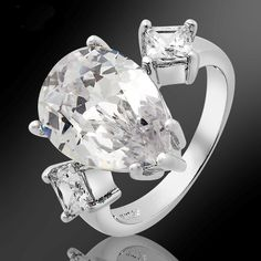 'PEAR CUT TOPAZ 18K GP RING SIZE 8' is going up for auction at  6am Fri, Aug 3 with a starting bid of $5.