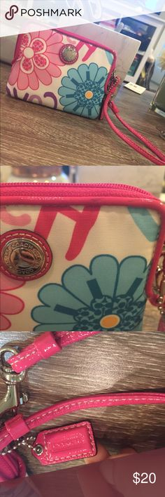 """Authentic floral Coach wristlet Monogram and floral print on white background with pink trim. Great for a gift or when you just need the essentials!! Minor """"scuff"""" shown on trim in picture. Coach Bags Clutches & Wristlets"""