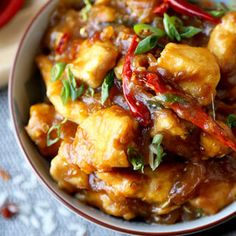 Sweet and sour Empress Chicken Recipe that's better than takeout! This is an easy stir fry with tender chicken pieces and vegetables ready in 20 minutes.