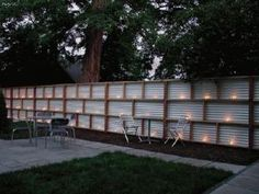 Corrugated metal, which would complement any house siding, but maybe they are too similar to the house.