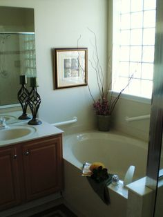 Making an empty bathroom seem inviting to sell this home. ~ Encore Home Staging and Redesign ~