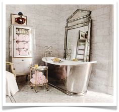 love the mirror..and the towel cabinet and pale pink towels....man i wish my bathroom was bigger....