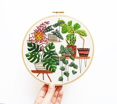 This is my dream garden!  All of my embroidery hoop art pieces are original designs and meticulously hand stitched. I emphasize clean, contemporary