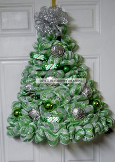 Be the talk of your neighborhood by displaying this Lime Green & White Striped Metallic Mesh Door/Wall Lighted Christmas tree wreath on your door,