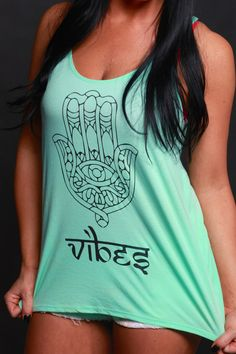 Flowy Mint tanks!!! You can't help but love this tank... All good vibes! Tank top runs a little big, you may want to order a size smaller than normal. Sizing: - Small: 2-4 - Medium: 6-10 - Large: 10-1