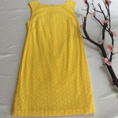 Ann Taylor loft size 6 dress yellow In great condition, yellow, with leaf like pattern throughout the dress, zipper closure on the back. Dresses Midi