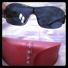 f0af6a4b165 I just discovered this while shopping on Poshmark  Prada black and silver  wrap around sunglasses