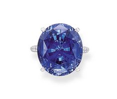 AN ELEGANT SAPPHIRE RING, BY GIMEL   Set with a modified oval-cut sapphire weighing 25.08 carats to the circular-cut diamond gallery and shoulders, mounted in platinum, size 5½, in a Gimel grey suede case  Signed Gimel