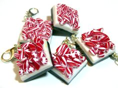Peppermint bark is my favorite Christmas candy. For me, its appearance on store shelves signals the beginning of the holiday season. This charm is an imitation of the real thing: A layer of white chocolate sandwiched between a bottom layer of dark chocolate, and a top layer of candy cane pieces. Sculpted from polymer clay and finished with satin glaze. Charm is photographed next to a US quarter for size reference.  Charm includes a jump ring and lobster clasp that can be easily attached to…