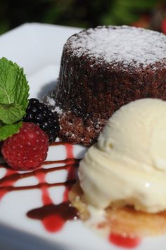Chocolate Lava Cake   Warm cake of chocolate and coffee   Served with vanilla gelato and fresh raspberries at the Atoll