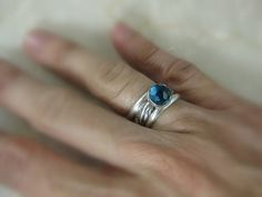 silver stacking rings with faceted london blue by formandfunktion