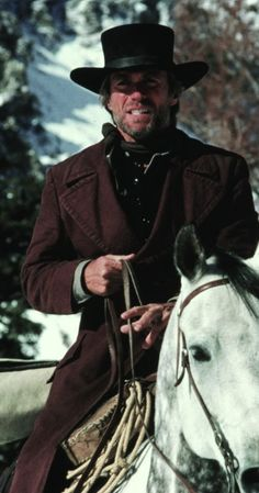 Preacher - Pale Rider - (Clint Eastwood) - Returned from the grave (?) to champion a group of miners beset by an evil Western capitalist, and to avenge himself against his killer - BA