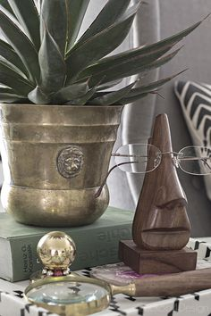 quirky home decor with wooden glasses holder and some brass accents