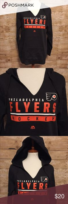 Women's NHL Philadelphia Flyers Split Neck Hoodie Brand new with tags. Long Sleeve split neck Pullover draw string hoodie. Kangaroo pockets and band cuffs on sleeves. Officially licensed by the NHL. Team Name on Chest of Sweatshirt.             Fabric:  80% Cotton, 20% Polyester. Majestic Tops Sweatshirts & Hoodies