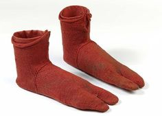The sands of the Greek city of Oxyrhynchus in Egypt famously preserved a collection of papyri so huge that scholars have still only gone through 15% of them. The sand also kept a pair of flame-red wool split-toe socks from 250-420 AD in flawless condition