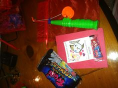 Easy to do Valentine gift, Dollar Store fishing pole, 10-20 cent organza bag, valentine candy (swedish fish and Trolli gummy worms or crawlers), home made card....Priceless when you hand them out!