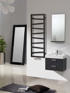 Romeo towel radiator: an unusual heated towel rail. It is ideal for all modern bathrooms. This designer radiator is avaible in a wide variety of heights and colours. Radiators Uk, Bathroom Radiators, Towel Heater, Master Bathroom Vanity, Bathroom Black, Heating And Plumbing, Towel Radiator, Black Towels, Designer Radiator