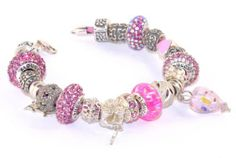 "Alducchi Pink Swarovski Crystal, Opal and 925 Sterling Silver Pandora style Charm Beads on Braided Leather Bracelet 7 1/2 inch long (fit up to 6"" wrist) Alducchi. $389.95. 11 sterling silver bead,2 sterling silver bead with pink crystals. 4 ALDUCCHI Pink CRYSTAL Bead,1 Alducchi  Pink Lab Opal bead. 7.5 inch Pink Braided Leather bracelet with Sterling silver lobster clasp. Ships in black velvet jewelry box + black velvet pouch. 2 sterling silver charm bead ,2 sterlin..."