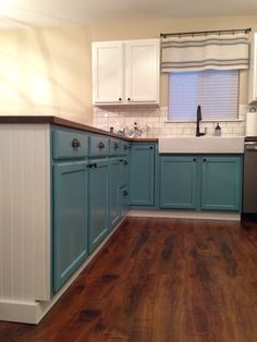 Kitchen reno! DIY Annie Sloan chalk paint cabinets with beadboard. IKEA butcher block counters and farmhouse sink!