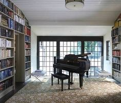 don't really like that the piano is the only furniture, don't you need a few chairs to read the books? But I do like the books and piano combo Grand Piano Room, Piano Room Decor, Birmingham, Music Studio Room, White Rooms, House In The Woods, My Dream Home, Future House, Building A House