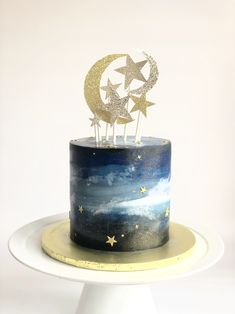 Baby shower cake. Moons and stars. Glitter topper. Hand painted fondant cake.