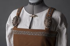 Viking dress with brooch close