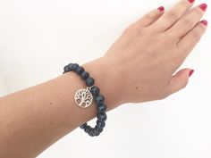 A personal favorite from my Etsy shop https://www.etsy.com/il-en/listing/469645496/black-pearl-beaded-bracelet-silver-tree