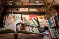 Girl at bookstore - At the Store, Family Documentary Photography