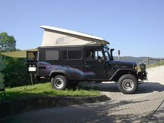 Black BJ45 with special striping and a pop up tent