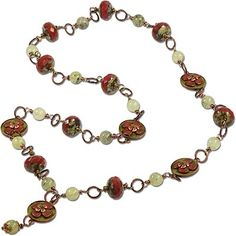 Picasso's Rusted Rose Petals Necklace uses wire wrapping and jump rings to combine the elements.