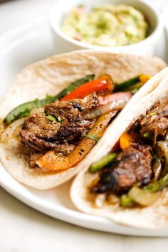 The absolute BEST Steak Fajitas you've ever had! This is my take on the tex-mex steak fajitas. Marinated for hours in lime juice, garlic, and cumin — so good you'll never use another recipe again! Holy Guacamole! And i'm not just saying that because steak fajitas NEED guacamole. I'm saying it because you need these …