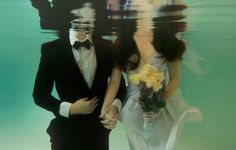 I think underwater wedding pictures are so cute(and original...the first time I saw them). I figure you wear a dress once, who cares if you jump in an ocean in it after the big day?
