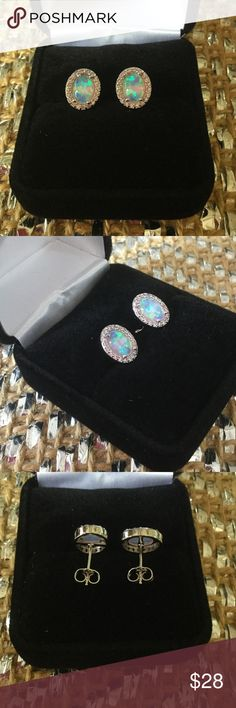 Pink Opal Dainty Earrings This romantic set of earrings is a must have !  Very expensive looking,  surrounded by pink Topaz crystals set in .925 and surgical steel posts.  A subtle look yet mysterious. Boutique Jewelry Earrings
