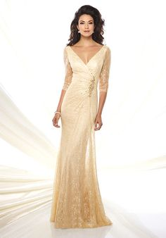 Lace slim A-line gown with illusion lace three-quarter length sleeves, front and back wide V-necklines, surplus bodice with hand-beaded motif at side, slim skirt with side draped lace overskirt, sweep train. Removable modesty piece included.