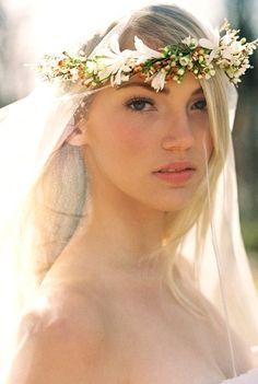 Bride's down wedding hairstyle with Renaissance veil flower crown