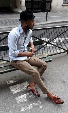 d2eaf4a547d56 Nail that dapper look with a grey button-down shirt and brown dress pants.